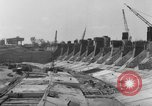 Image of dam under construction United States USA, 1956, second 55 stock footage video 65675070983