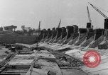 Image of dam under construction United States USA, 1956, second 57 stock footage video 65675070983