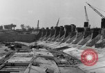 Image of dam under construction United States USA, 1956, second 59 stock footage video 65675070983