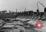 Image of dam under construction United States USA, 1956, second 60 stock footage video 65675070983