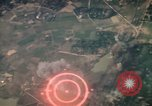 Image of air strikes on road intersection Vietnam, 1967, second 2 stock footage video 65675071012