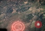 Image of air strikes on road intersection Vietnam, 1967, second 7 stock footage video 65675071012
