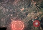 Image of air strikes on road intersection Vietnam, 1967, second 10 stock footage video 65675071012