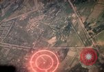 Image of air strikes on road intersection Vietnam, 1967, second 12 stock footage video 65675071012