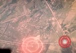 Image of air strikes on road intersection Vietnam, 1967, second 13 stock footage video 65675071012