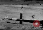 Image of Viet Cong attack U.S.soldiers in crashed helicopter Vietnam, 1965, second 10 stock footage video 65675071042