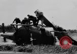 Image of Viet Cong attack U.S.soldiers in crashed helicopter Vietnam, 1965, second 15 stock footage video 65675071042