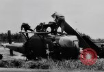 Image of Viet Cong attack U.S.soldiers in crashed helicopter Vietnam, 1965, second 16 stock footage video 65675071042