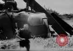 Image of Viet Cong attack U.S.soldiers in crashed helicopter Vietnam, 1965, second 17 stock footage video 65675071042