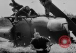 Image of Viet Cong attack U.S.soldiers in crashed helicopter Vietnam, 1965, second 18 stock footage video 65675071042