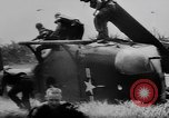 Image of Viet Cong attack U.S.soldiers in crashed helicopter Vietnam, 1965, second 19 stock footage video 65675071042