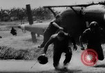 Image of Viet Cong attack U.S.soldiers in crashed helicopter Vietnam, 1965, second 20 stock footage video 65675071042