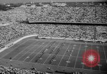 Image of Army versus Rice football Houston Texas USA, 1958, second 7 stock footage video 65675071117