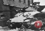 Image of US Soldiers examine damaged US M4 and German Panther tank Sterpigny Belgium, 1945, second 8 stock footage video 65675071156