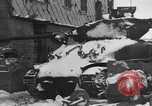 Image of US Soldiers examine damaged US M4 and German Panther tank Sterpigny Belgium, 1945, second 10 stock footage video 65675071156