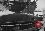 Image of US Soldiers examine damaged US M4 and German Panther tank Sterpigny Belgium, 1945, second 14 stock footage video 65675071156