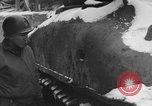 Image of US Soldiers examine damaged US M4 and German Panther tank Sterpigny Belgium, 1945, second 17 stock footage video 65675071156
