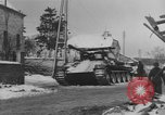 Image of US Soldiers examine damaged US M4 and German Panther tank Sterpigny Belgium, 1945, second 32 stock footage video 65675071156