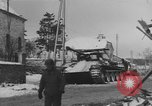Image of US Soldiers examine damaged US M4 and German Panther tank Sterpigny Belgium, 1945, second 37 stock footage video 65675071156
