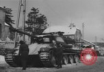 Image of US Soldiers examine damaged US M4 and German Panther tank Sterpigny Belgium, 1945, second 38 stock footage video 65675071156