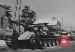 Image of US Soldiers examine damaged US M4 and German Panther tank Sterpigny Belgium, 1945, second 39 stock footage video 65675071156