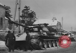 Image of US Soldiers examine damaged US M4 and German Panther tank Sterpigny Belgium, 1945, second 40 stock footage video 65675071156