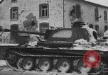Image of US Soldiers examine damaged US M4 and German Panther tank Sterpigny Belgium, 1945, second 44 stock footage video 65675071156