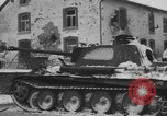 Image of US Soldiers examine damaged US M4 and German Panther tank Sterpigny Belgium, 1945, second 47 stock footage video 65675071156