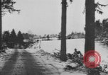 Image of US Soldiers examine damaged US M4 and German Panther tank Sterpigny Belgium, 1945, second 62 stock footage video 65675071156
