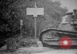 Image of Renault FT tank runs down a street sign Western Front, 1918, second 6 stock footage video 65675071196