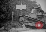 Image of Renault FT tank runs down a street sign Western Front, 1918, second 7 stock footage video 65675071196