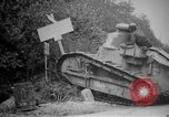 Image of Renault FT tank runs down a street sign Western Front, 1918, second 9 stock footage video 65675071196