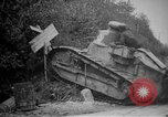Image of Renault FT tank runs down a street sign Western Front, 1918, second 10 stock footage video 65675071196