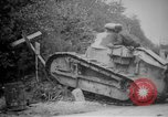 Image of Renault FT tank runs down a street sign Western Front, 1918, second 15 stock footage video 65675071196