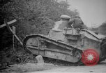Image of Renault FT tank runs down a street sign Western Front, 1918, second 16 stock footage video 65675071196