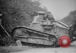 Image of Renault FT tank runs down a street sign Western Front, 1918, second 17 stock footage video 65675071196