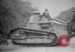 Image of Renault FT tank runs down a street sign Western Front, 1918, second 18 stock footage video 65675071196