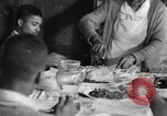 Image of African American  farmers eating dinner United States USA, 1931, second 56 stock footage video 65675071226