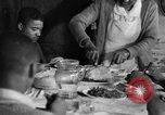 Image of African American  farmers eating dinner United States USA, 1931, second 59 stock footage video 65675071226