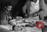 Image of African American  farmers eating dinner United States USA, 1931, second 61 stock footage video 65675071226
