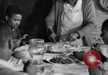 Image of African American  farmers eating dinner United States USA, 1931, second 62 stock footage video 65675071226
