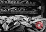 Image of bread supplied to Italian citizens in World War 2 Italy, 1944, second 26 stock footage video 65675071256