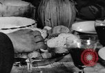 Image of bread supplied to Italian citizens in World War 2 Italy, 1944, second 35 stock footage video 65675071256