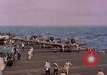 Image of F6Fs and SBD Douglas Dauntless on flight deck of USS Lexington Pacific Ocean, 1944, second 45 stock footage video 65675071278
