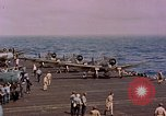 Image of F6Fs and SBD Douglas Dauntless on flight deck of USS Lexington Pacific Ocean, 1944, second 46 stock footage video 65675071278
