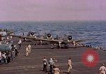 Image of F6Fs and SBD Douglas Dauntless on flight deck of USS Lexington Pacific Ocean, 1944, second 47 stock footage video 65675071278