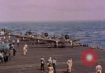 Image of F6Fs and SBD Douglas Dauntless on flight deck of USS Lexington Pacific Ocean, 1944, second 48 stock footage video 65675071278