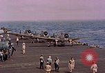Image of F6Fs and SBD Douglas Dauntless on flight deck of USS Lexington Pacific Ocean, 1944, second 49 stock footage video 65675071278