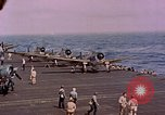 Image of F6Fs and SBD Douglas Dauntless on flight deck of USS Lexington Pacific Ocean, 1944, second 51 stock footage video 65675071278