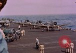 Image of F6Fs and SBD Douglas Dauntless on flight deck of USS Lexington Pacific Ocean, 1944, second 55 stock footage video 65675071278